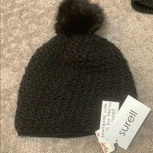 black beanie with pom pom